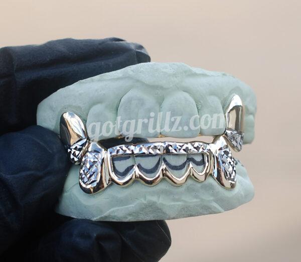 Yellow gold Diamond cut K9 fangs and bottoms grillz - GotGrillz